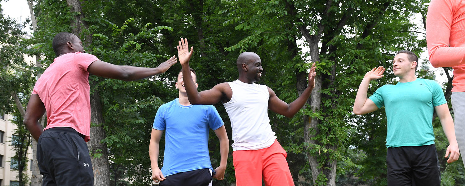 Fitness members high-five after workout