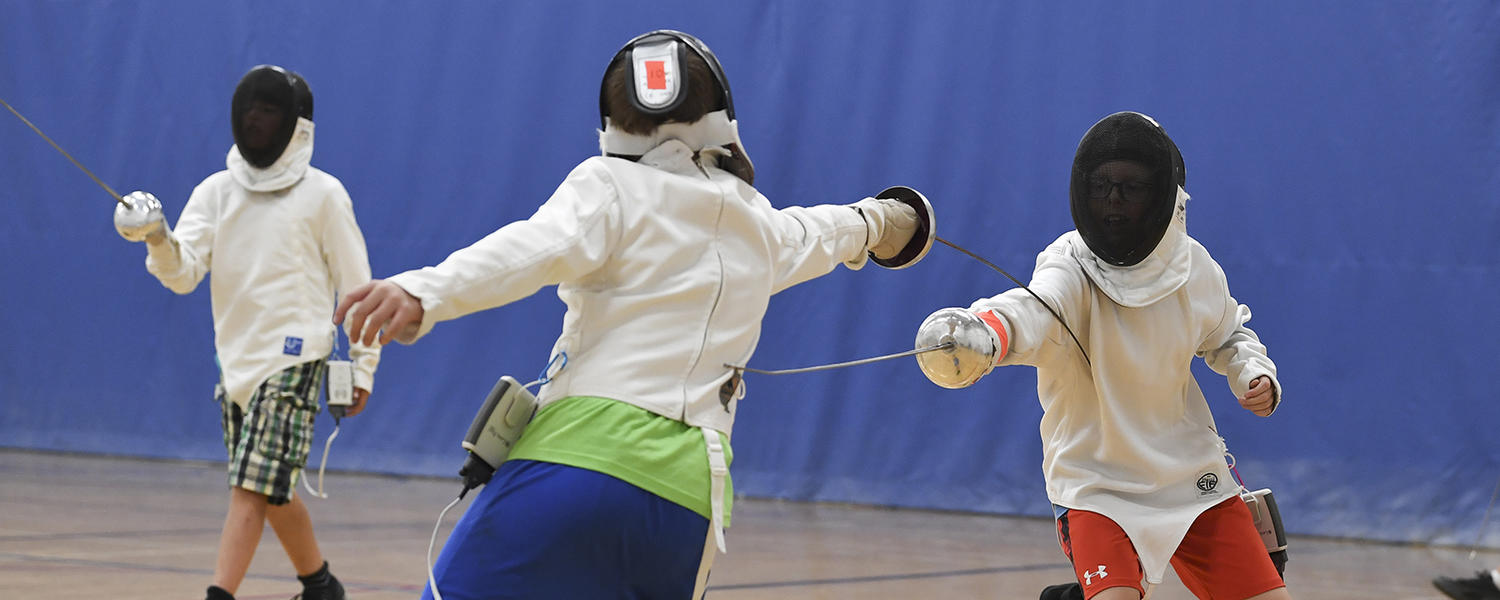 Kids fencing in University of Calgary gym