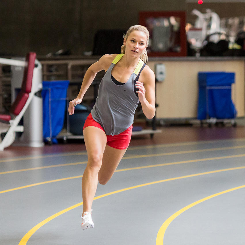 Woman sprinting on indoor track
