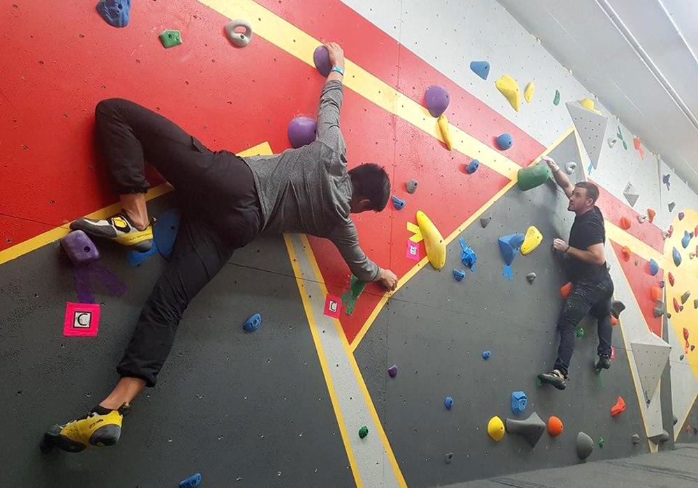 Students climb on UCalgary Bouldering Wall