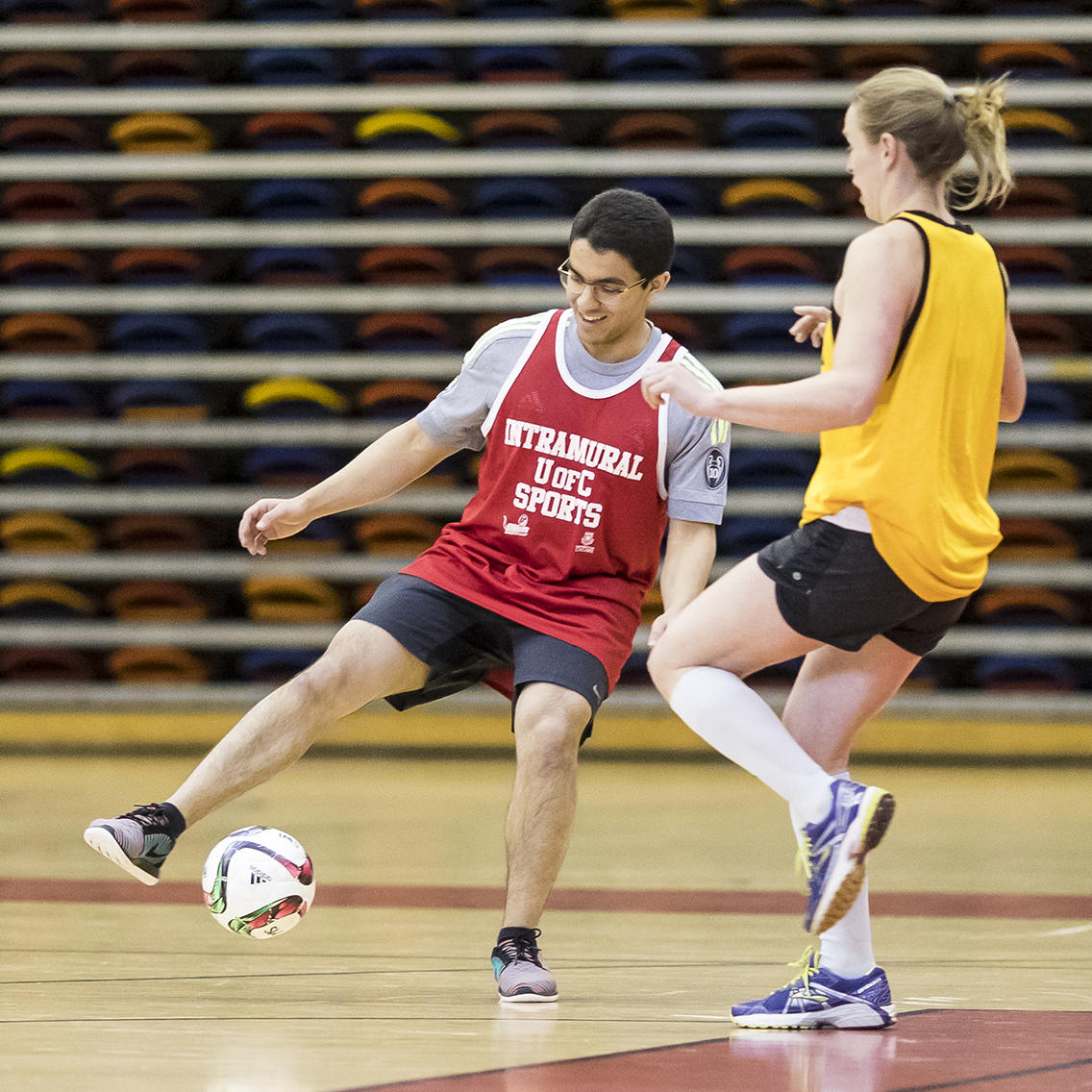 coed-soccer game in a gym