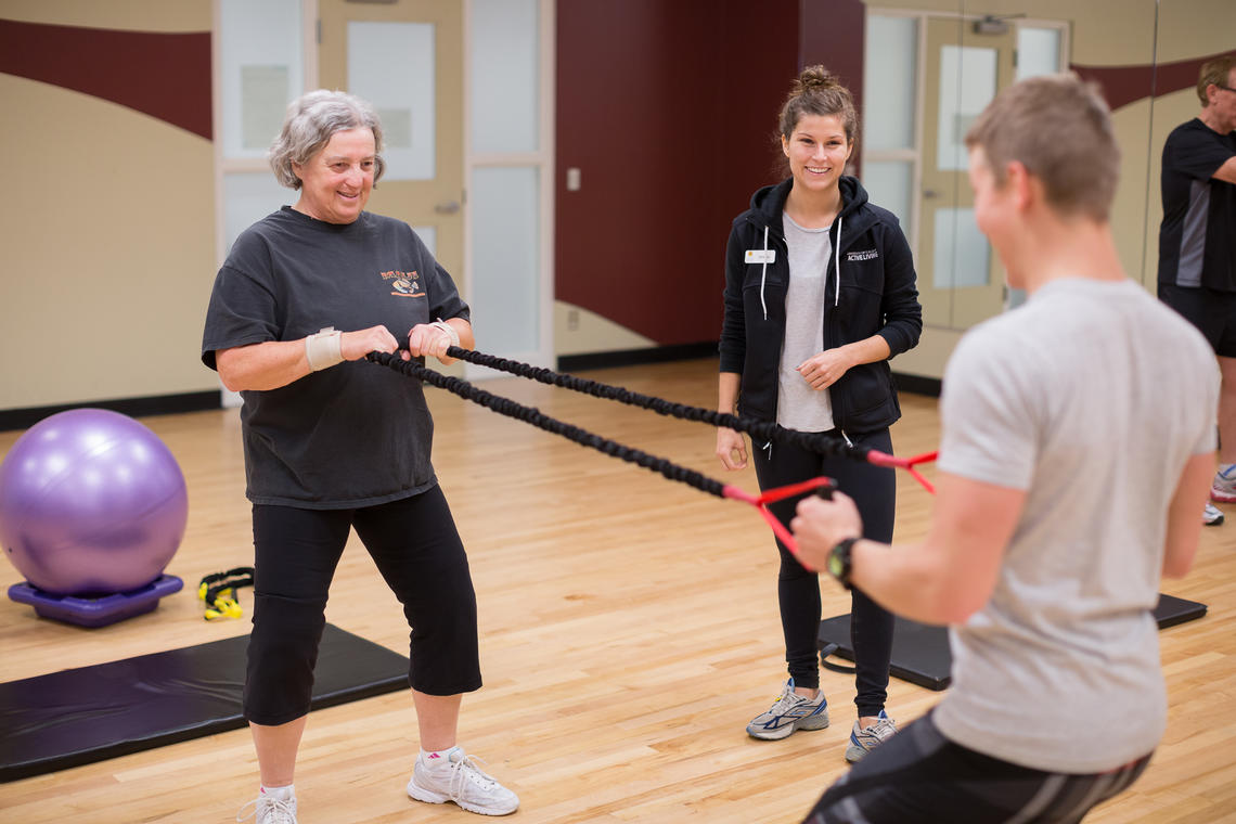 TrymGym client does resistance band workout with a personal trainer
