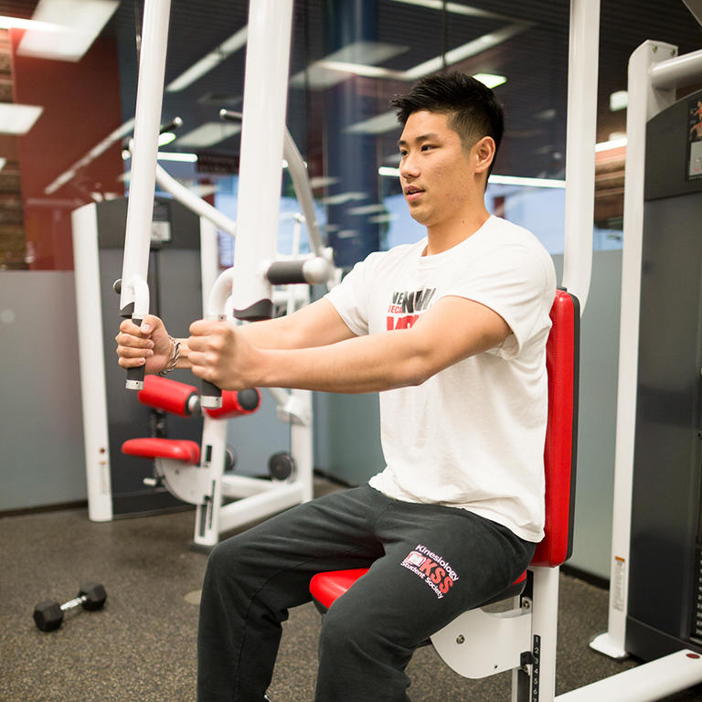 man working out with fitness equipment