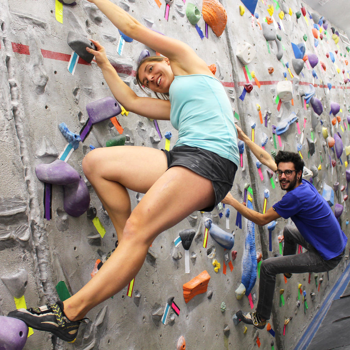 young woman climbing on bouldering wall