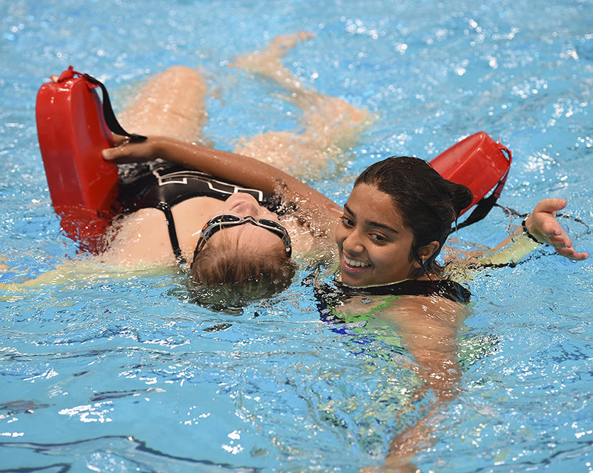Female lifeguards practising skills at UCalgary Aquatic Centre
