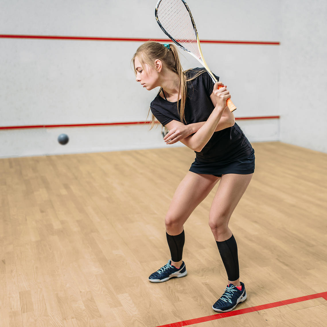 Squash player in a court