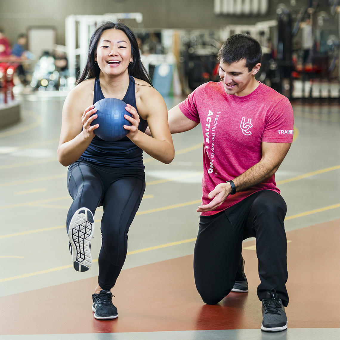 Woman receiving personal training session at UCalgary Fitness Centre