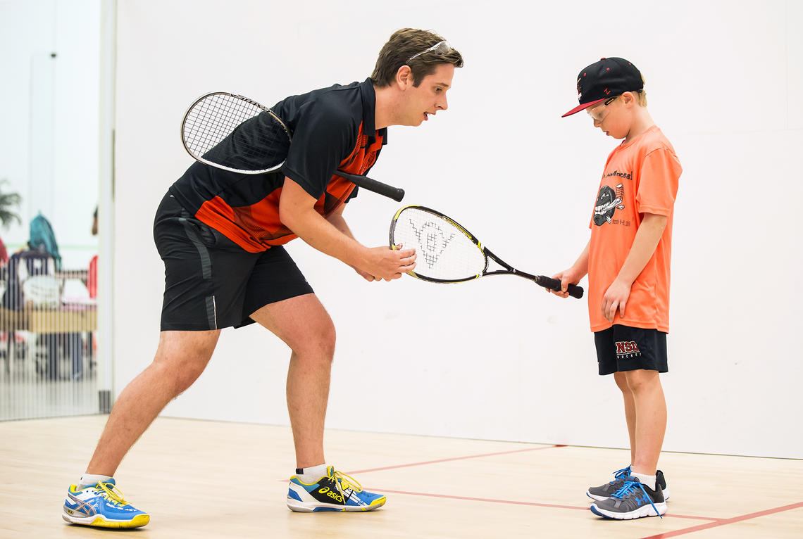 UCalgary Racquet instructor with camps kids