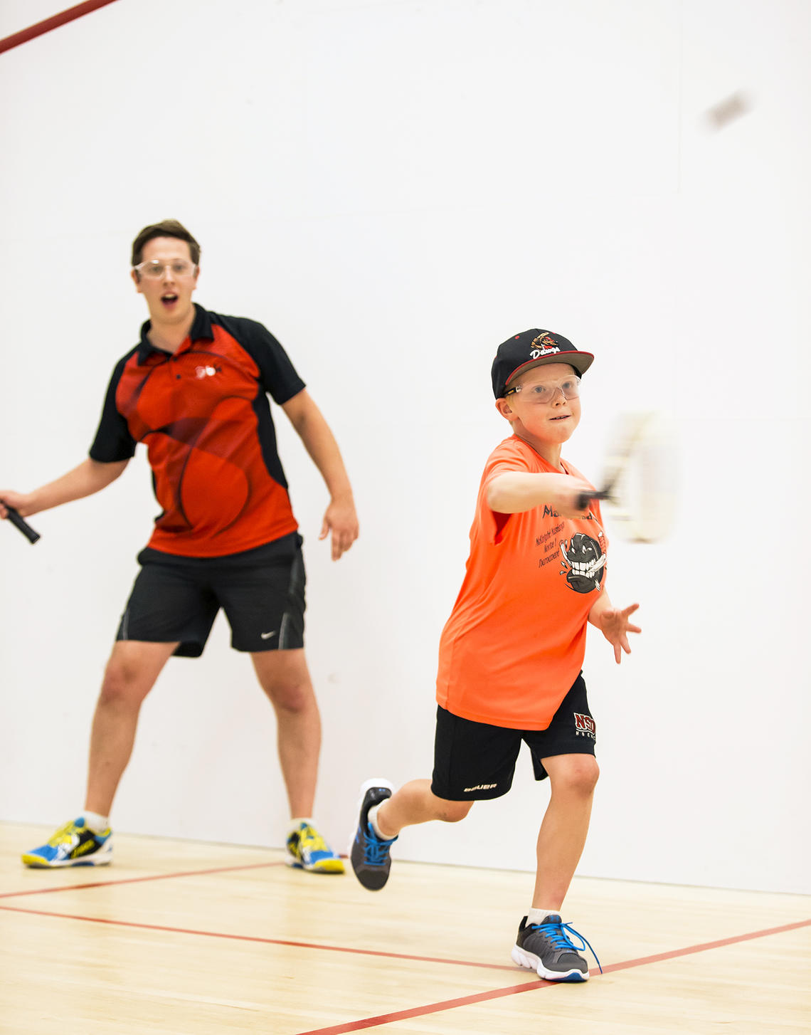 Boy in a racquet sport lesson at UCalgary