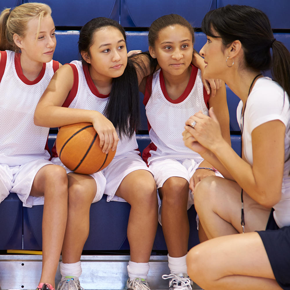 Woman coaching basketball team