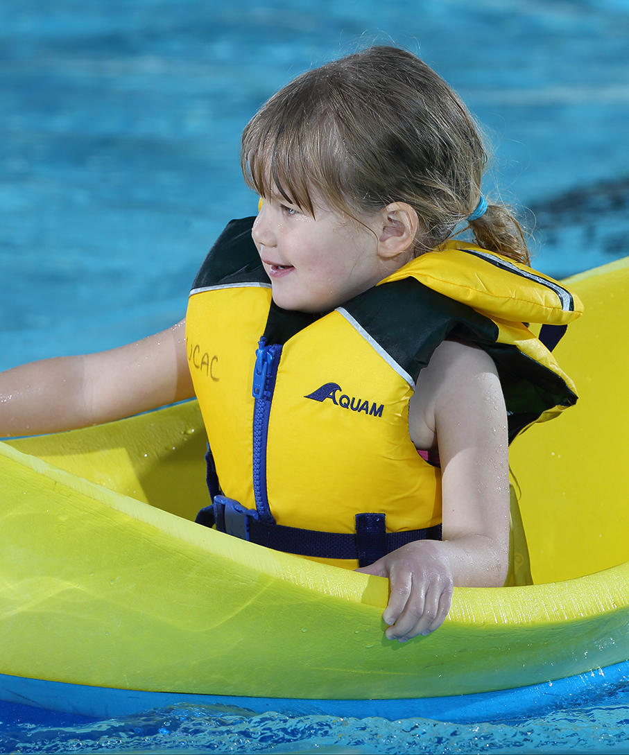 Girl wearing lifejacket in the UCalgary Aquatic Centre