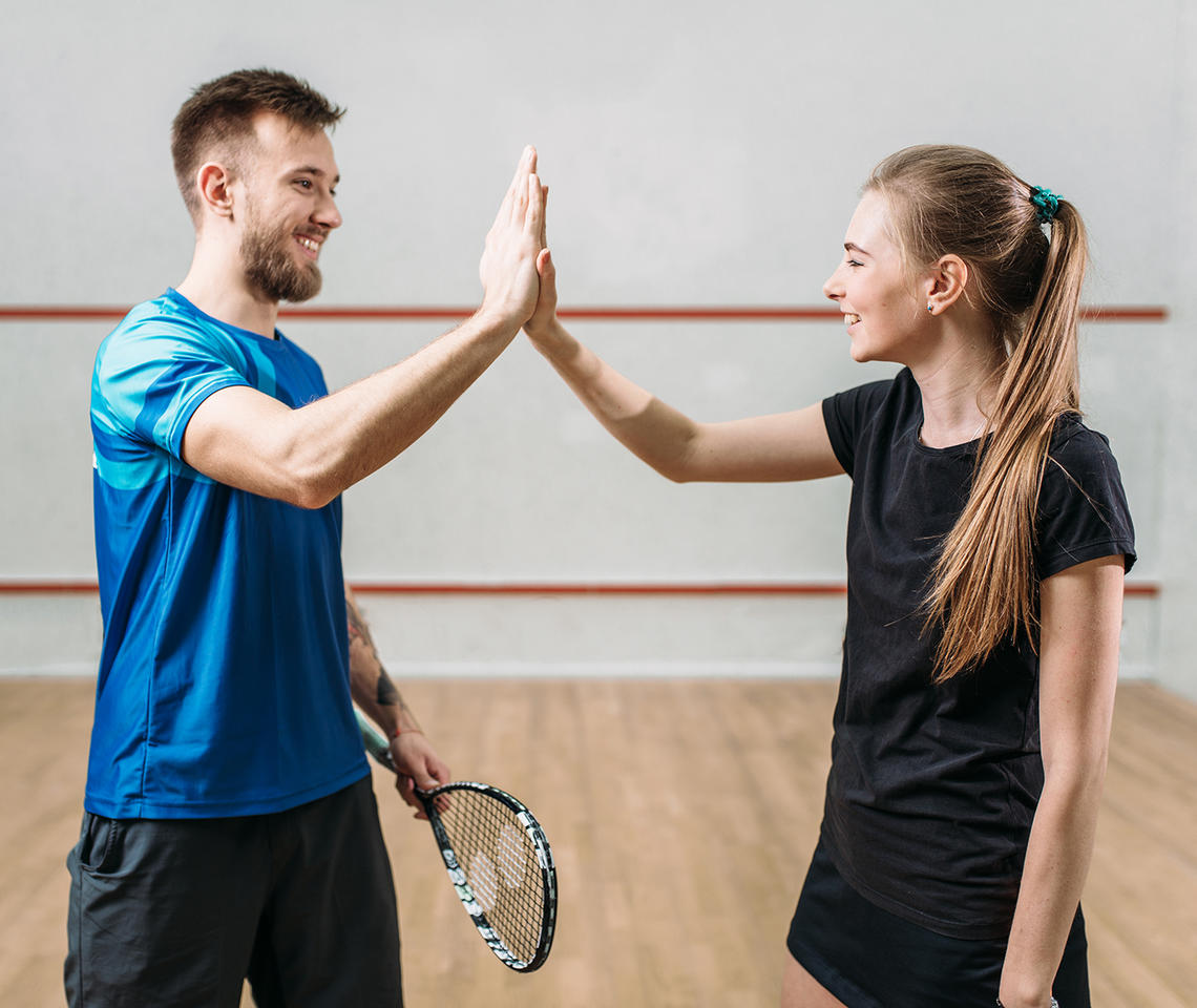 Man and woman in racquet centre
