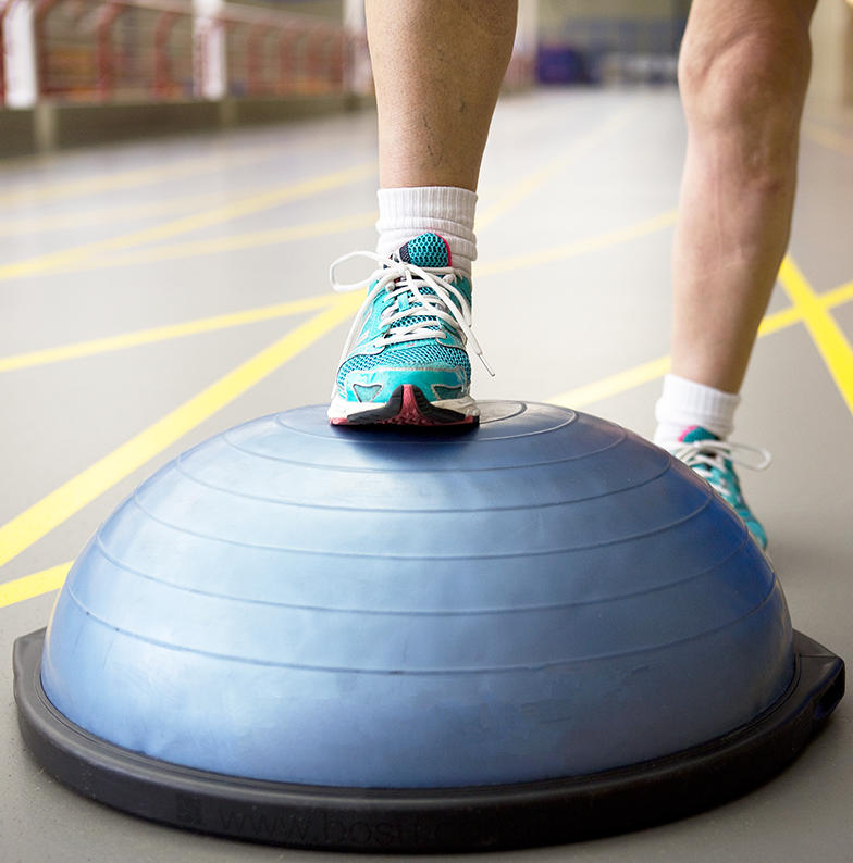JointEffort patient places foot on fitness ball