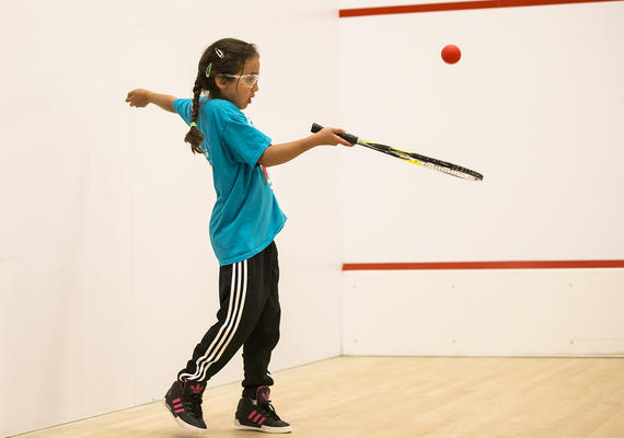Kid playing racquet sports at University of Calgary