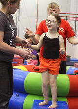 Young girl learning gymnastics at UCalgary